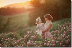woman-retro-dress-with-her-daughter-5-years-old-walking-spring-field-with-roses_143465-1066